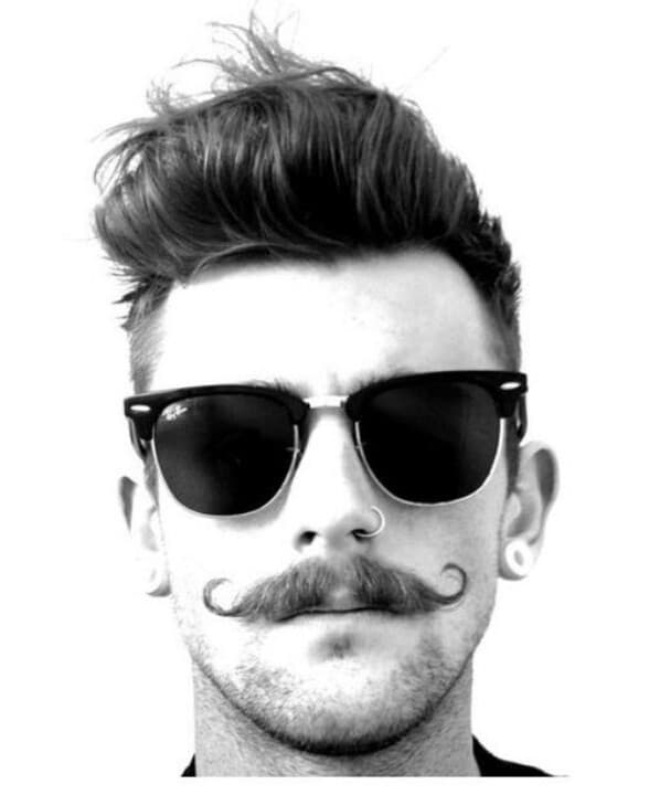 Handle bar mustache with a beard