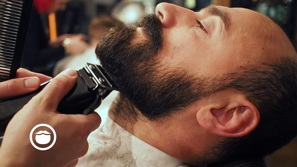 Trimming a mustache with a beard